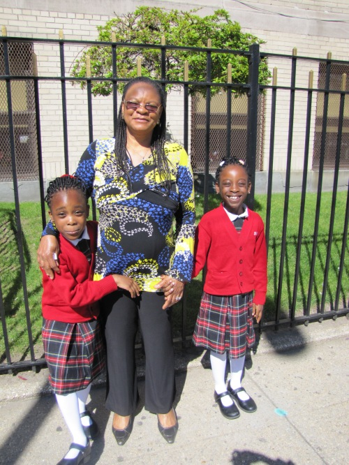 Mrs. Obazee and her twin daughters outside St. Mark School in Brooklyn.